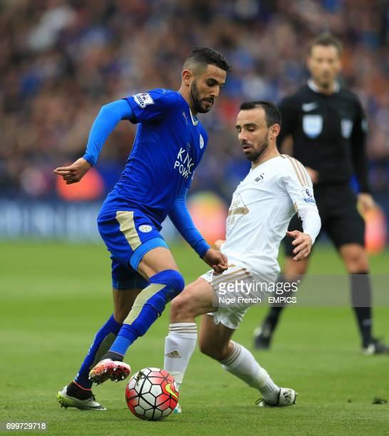 Leicester City's Riyad Mahrez and Swansea City's Leon Britton battle for the ball