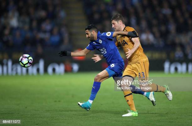 Leicester City's Riyad Mahrez and Tottenham Hotspur's Ben Davies battle for the ball during the Premier League match at the King Power Stadium...