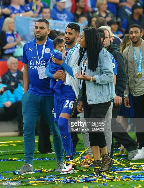 Leicester City's Riyad Mahrez celebrates with his family