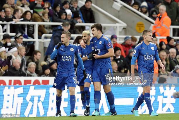 Leicester City's Riyad Mahrez celebrates with team mate Harry Maguire after scoring his side's equalising goal to make the score 11 during the...