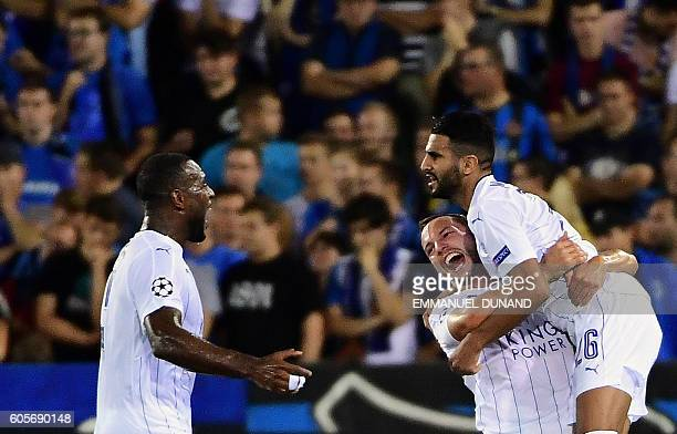 Leicester City's Riyad Mahrez celebrates with teammates after scoring a goal during the UEFA Champions League football match between Club Brugge and...