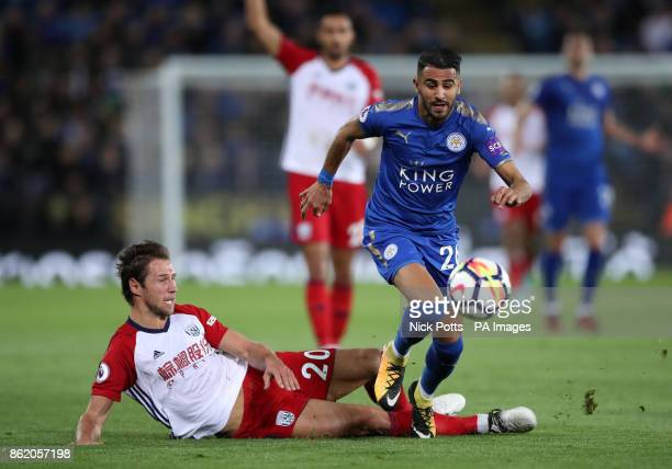 Leicester City's Riyad Mahrez is challenged by West Bromwich Albion's Grzegorz Krychowiak during the Premier League match at the King Power Stadium...
