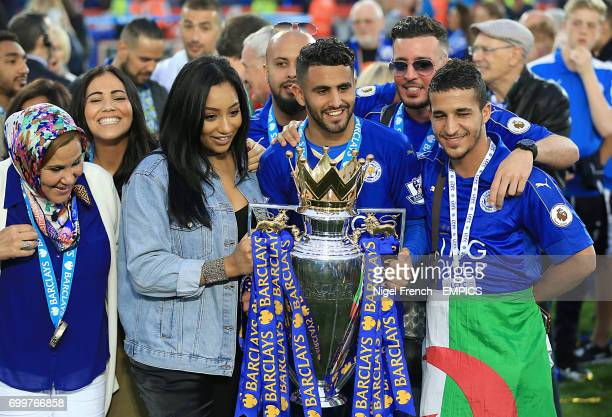 Leicester City's Riyad Mahrez poses with his family and the Barclays Premier League trophy