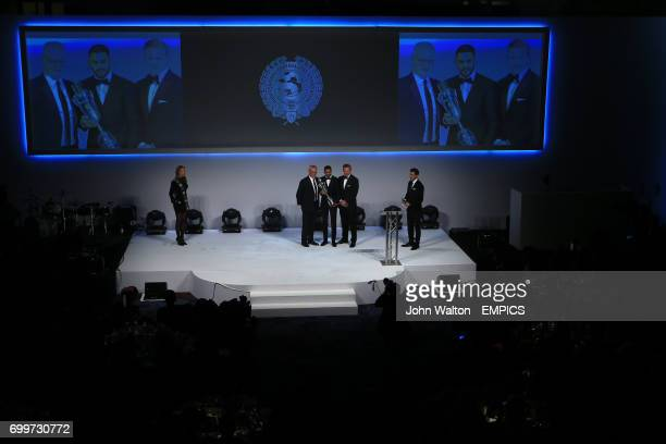 Leicester City's Riyad Mahrez poses with his PFA Men's Player of the Year Award alongside Leicester City manager Claudio Ranieri and PFA Chairman...