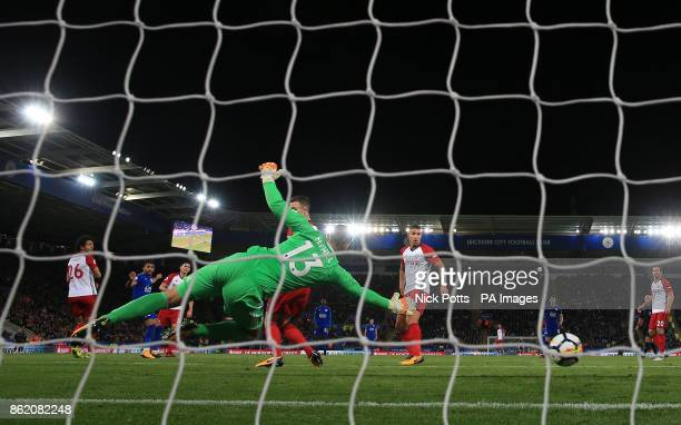 Leicester City's Riyad Mahrez scores his side's first goal of the game during the Premier League match at the King Power Stadium Leicester