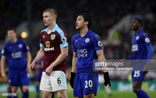 Leicester City's Shinji Okazaki and Burnley's Ben Mee during the Premier League match between Burnley and Leicester City at Turf Moor on January 31...