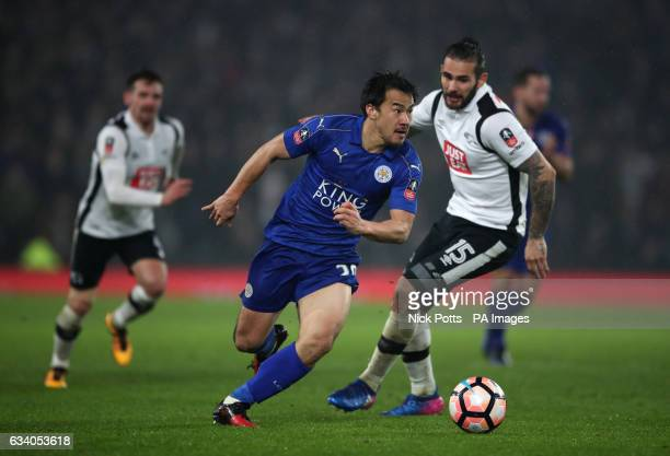 Leicester City's Shinji Okazaki and Derby County's Bradley Johnson battle for the ball