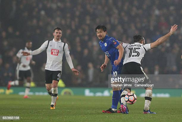 Leicester City's Shinji Okazaki and Derby County's Bradley Johnson during the Emirates FA Cup Fourth Round match between Derby County and Leicester...