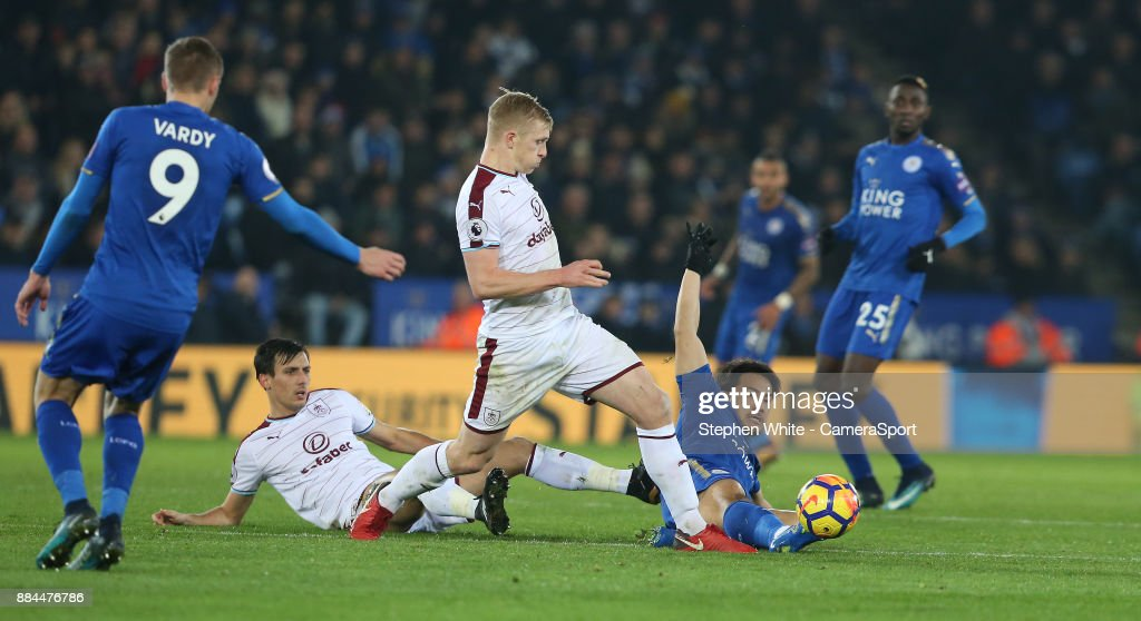 Leicester City's Shinji Okazaki battles with Burnley's Jack Cork and Ben Mee during the Premier League match between Leicester City and Burnley at The King Power Stadium on December 2, 2017 in Leicester, England.