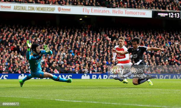Leicester City's Shinji Okazaki has an attempt on goal as Arsenal goalkeeper Petr Cech dives to stop it
