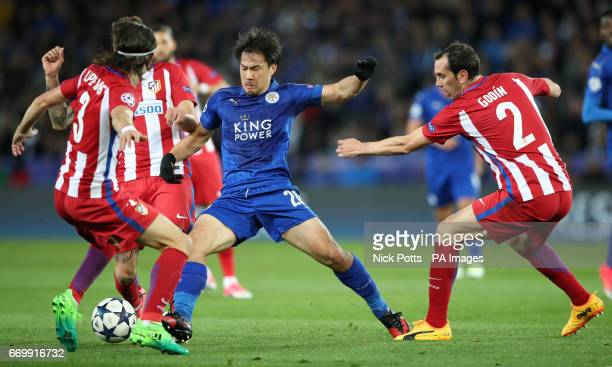 Leicester City's Shinji Okazaki is challenged by Atletico Madrid's Kasmirski Filipe Luis and Diego Godin during the second leg of the UEFA Champions...