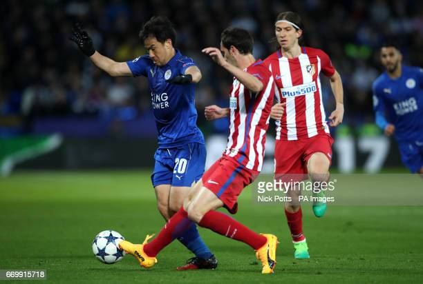 Leicester City's Shinji Okazaki is challenged during the second leg of the UEFA Champions League quarter final match at the King Power Stadium...