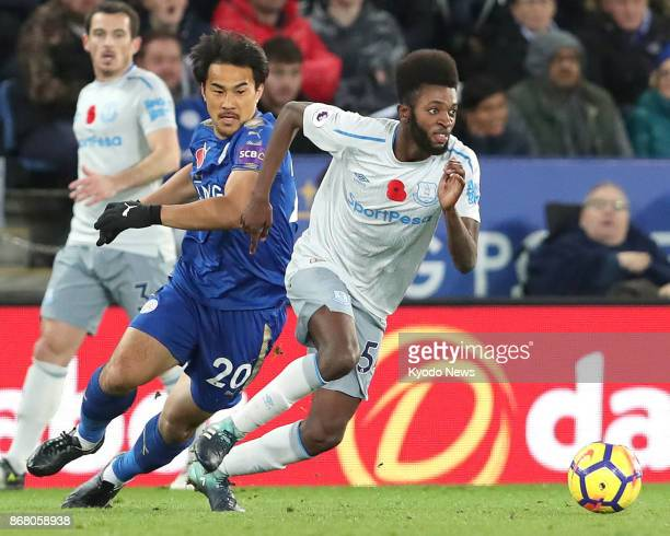 Leicester City's Shinji Okazaki pursues Beni Baningime of Everton during the second half of an English Premier League match at King Power Stadium in...