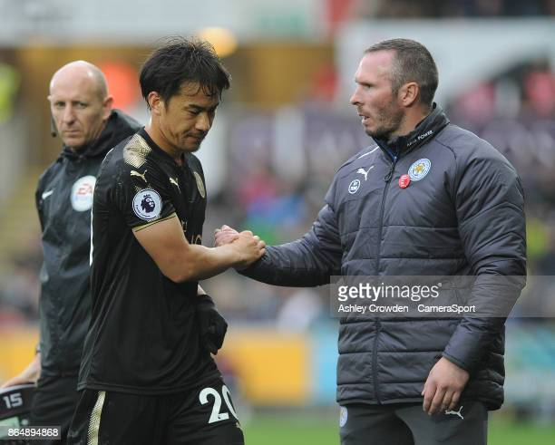 Leicester City's Shinji Okazaki shakes hands with Leicester City Caretaker Manager Michael Appleton after being taken off during the Premier League...