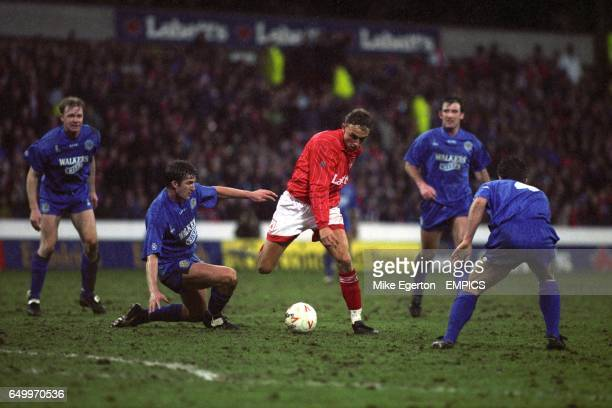Leicester City's Simon Grayson tackles Nottingham Forest's Lars Bohinen watched by Leicester City teammates David Oldfield and Jimmy Willis