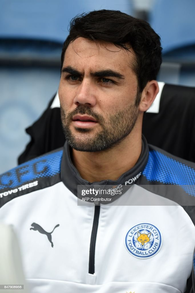Leicester City's Spanish midfielder Vicente Iborra takes his place on the bench ahead of the English Premier League football match between Huddersfield Town and Leicester City at the John Smith's stadium in Huddersfield, northern England on September 16, 2017. The game finished 1-1. / AFP PHOTO / Oli SCARFF / RESTRICTED TO EDITORIAL USE. No use with unauthorized audio, video, data, fixture lists, club/league logos or 'live' services. Online in-match use limited to 75 images, no video emulation. No use in betting, games or single club/league/player publications. /