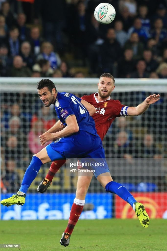 Leicester City's Spanish midfielder Vicente Iborra (L) vies with Liverpool's English midfielder Jordan Henderson (R) during the English League Cup third round football match between Leicester City and Liverpool at King Power Stadium in Leicester, central England on September 19, 2017. / AFP PHOTO / Lindsey PARNABY / RESTRICTED TO EDITORIAL USE. No use with unauthorized audio, video, data, fixture lists, club/league logos or 'live' services. Online in-match use limited to 75 images, no video emulation. No use in betting, games or single club/league/player publications. /