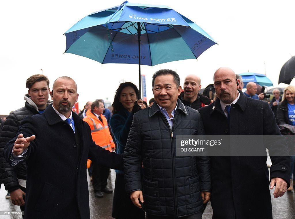 Leicester City's Thai chairman Vichai Srivaddhanaprabha (C) arrives at Old Trafford stadium before the English Premier League football match between Manchester United and Leicester City in Manchester, north west England, on May 1, 2016. / AFP / OLI SCARFF / RESTRICTED TO EDITORIAL USE. No use with unauthorized audio, video, data, fixture lists, club/league logos or 'live' services. Online in-match use limited to 75 images, no video emulation. No use in betting, games or single club/league/player publications. /