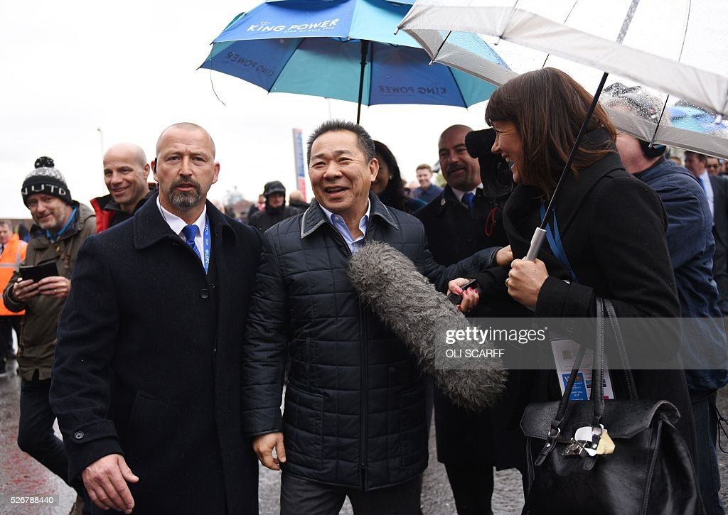 Leicester City's Thai chairman Vichai Srivaddhanaprabha (C) is interviewed on arrival at Old Trafford stadium before the English Premier League football match between Manchester United and Leicester City in Manchester, north west England, on May 1, 2016. / AFP / OLI SCARFF / RESTRICTED TO EDITORIAL USE. No use with unauthorized audio, video, data, fixture lists, club/league logos or 'live' services. Online in-match use limited to 75 images, no video emulation. No use in betting, games or single club/league/player publications. /