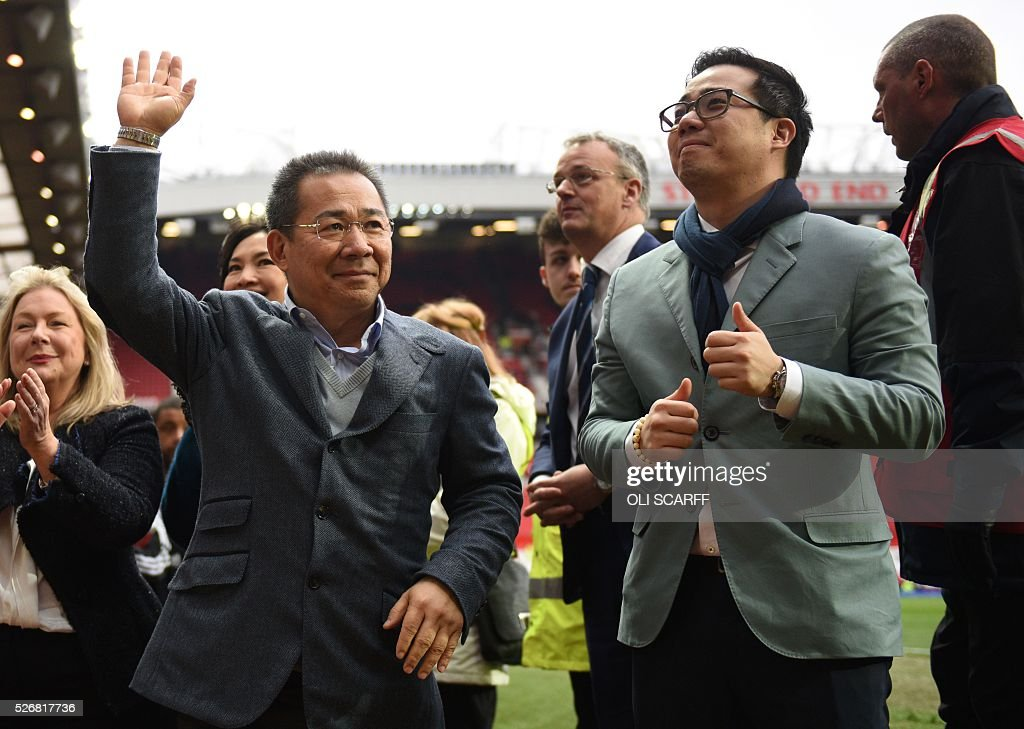 Leicester City's Thai chairman Vichai Srivaddhanaprabha (L) waves to fans after the English Premier League football match between Manchester United and Leicester City at Old Trafford in Manchester, north west England, on May 1, 2016. / AFP / OLI SCARFF / RESTRICTED TO EDITORIAL USE. No use with unauthorized audio, video, data, fixture lists, club/league logos or 'live' services. Online in-match use limited to 75 images, no video emulation. No use in betting, games or single club/league/player publications. /