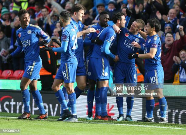 Leicester City's Vicente Iborra celebrates scoring the opening goal with teammates Jamie Vardy and Shinji Okazaki during the Premier League match...
