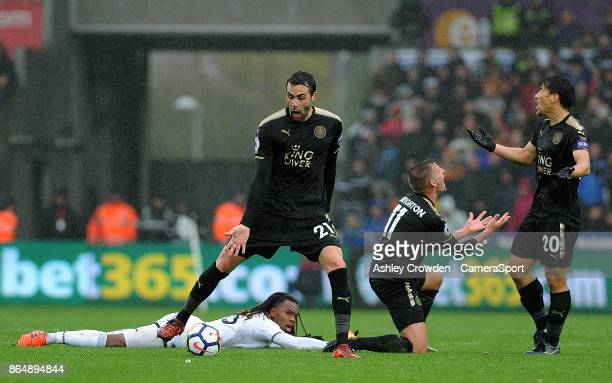 Leicester City's Vicente Iborra Marc Albrighton and Shinji Okazaki react to a foul against Swansea City's Renato Sanches during the Premier League...