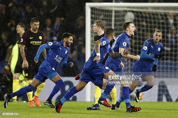 Leicester City's Welsh midfielder Andy King celebrates with teammates after scoring their second goal during the English Premier League football...