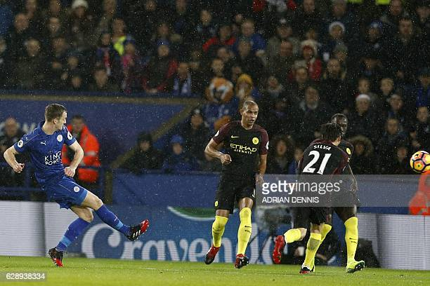 Leicester City's Welsh midfielder Andy King shoots to score their second goal during the English Premier League football match between Leicester City...