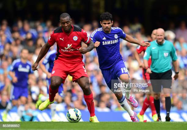 Leicester City's Wes Morgan and Chelsea's Diego Costa battle for the ball during the Barclays Premier League match at Stamford Bridge London