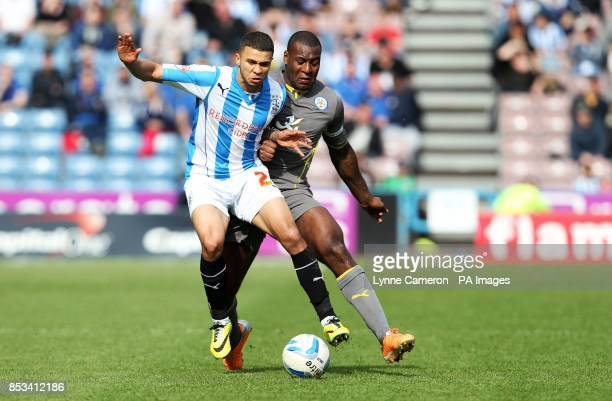 Leicester City's Wes Morgan and Huddersfield Town's Nahki Wells during the Sky Bet Championship match at the John Smith's Stadium Huddersfield