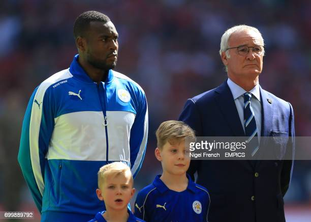 Leicester City's Wes Morgan and manager Claudio Ranieri stand during the National Anthem