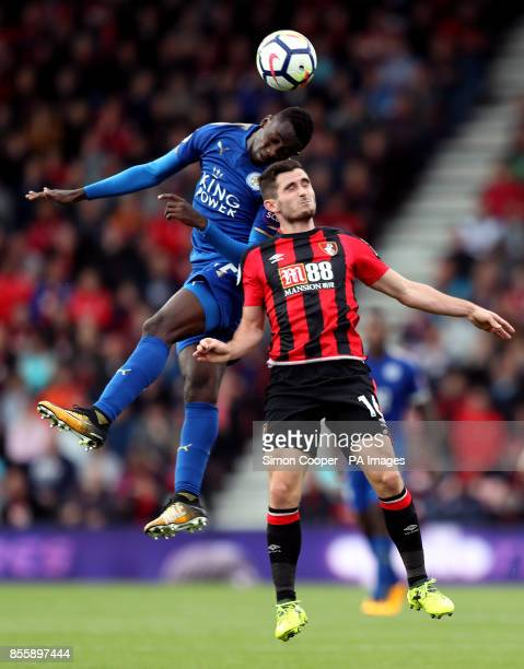 Leicester City's Wilfred Ndidi and AFC Bournemouth's Lewis Cook battle for the ball in the air during the Premier League match at the Vitality...