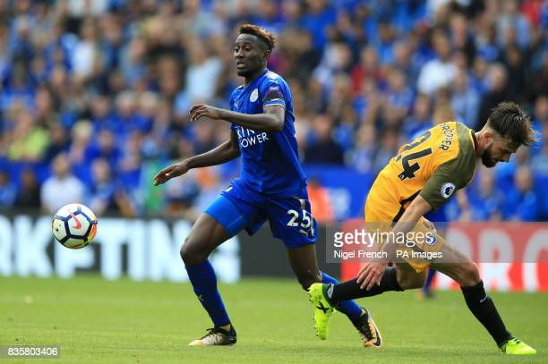 Leicester City's Wilfred Ndidi and Brighton Hove Albion's Davy Propper battle for the ball during the Premier League match at the King Power Stadium...