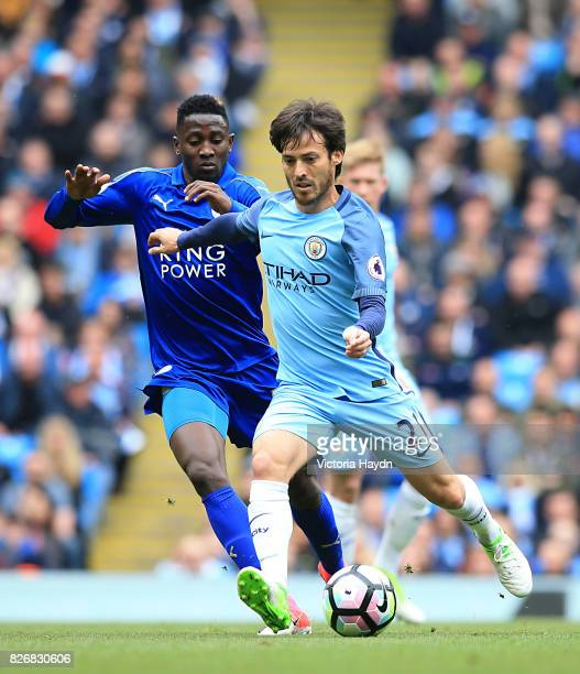 Leicester City's Wilfred Ndidi and Manchester City's David Silva battle for the ball