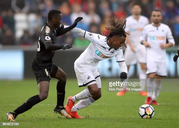 Leicester City's Wilfred Ndidi and Swansea City's Renato Sanches battle for the ball during the Premier League match at the Liberty Stadium Swansea