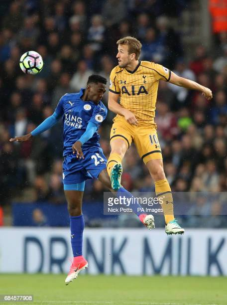 Leicester City's Wilfred Ndidi and Tottenham Hotspur's Harry Kane battle for the ball in the air during the Premier League match at the King Power...