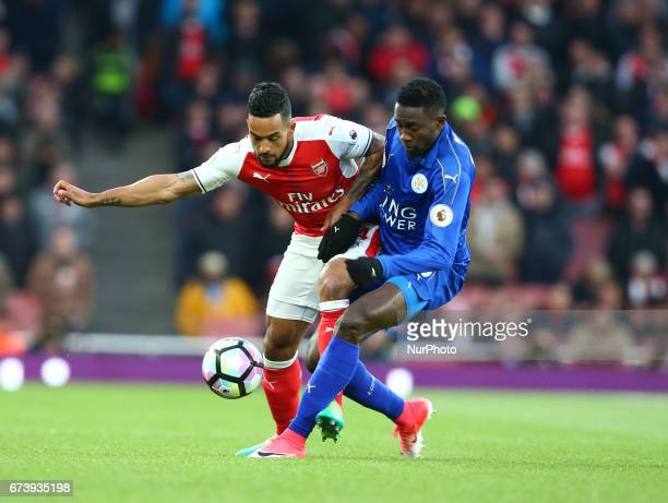 Leicester City's Wilfred Ndidi beats Arsenal's Theo Walcott during the Premier League match between Arsenal and Leicester City at Emirates stadium...