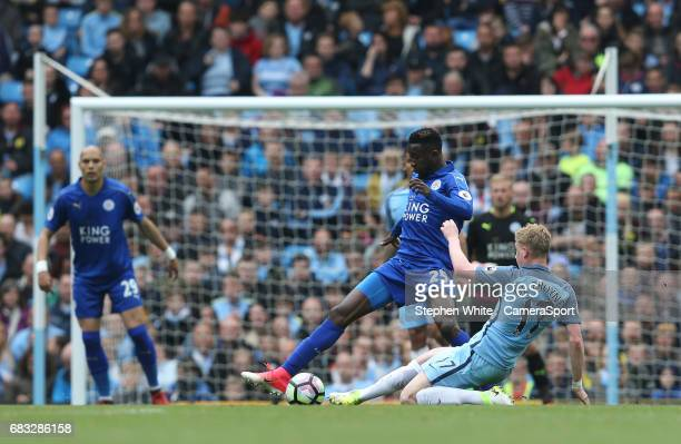 Leicester City's Wilfred Ndidi is tackled by Manchester City's Kevin De Bruyne during the Premier League match between Manchester City and Leicester...