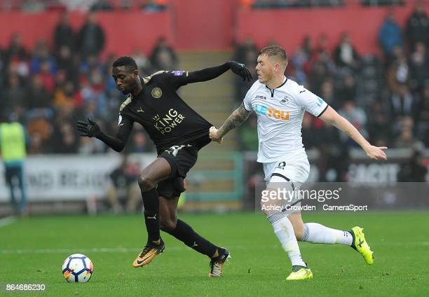 Leicester City's Wilfred Ndidi vies for possession with Swansea City's Alfie Mawson during the Premier League match between Swansea City and...