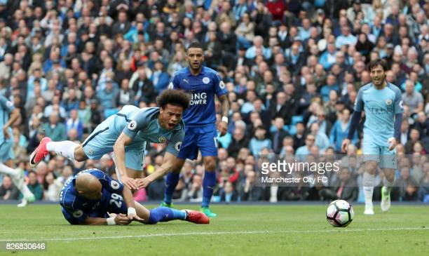 Leicester City's Yohan Benalouane challenges Manchester City's Leroy Sane resulting in a penalty