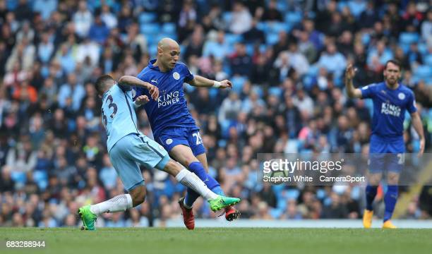 Leicester City's Yohan Benalouane is tackled by Manchester City's Gabriel Jesus during the Premier League match between Manchester City and Leicester...