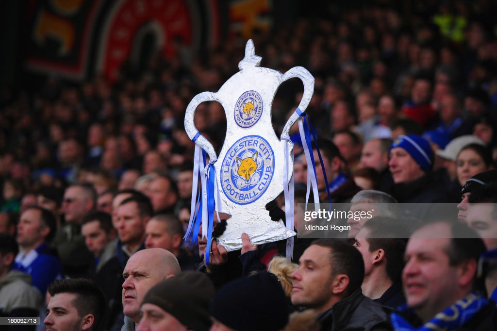 A Leicester fan holds up a replica FA Cup made of tin foil during the FA Cup Fourth Round match between Huddersfield Town and Leicester City at the Galpharm Stadium on January 26, 2013 in Huddersfield, England.