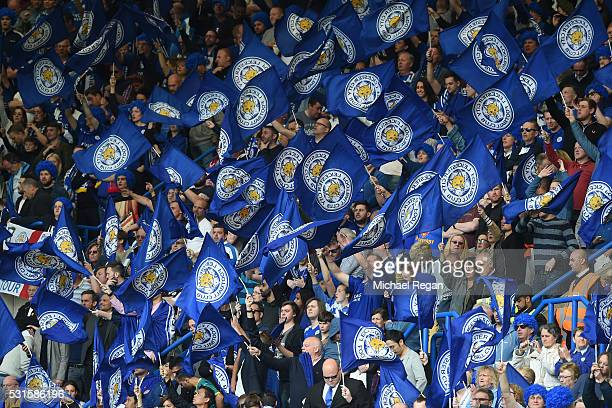 Leicester fans cheer on their team during the Barclays Premier League match between Chelsea and Leicester City at Stamford Bridge on May 15 2016 in...