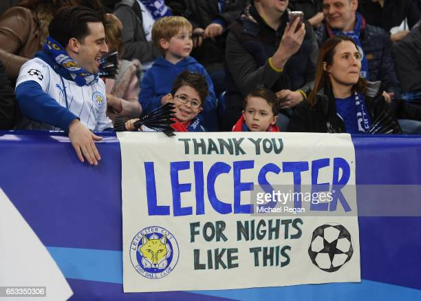 Leicester fans cheer on their team during the UEFA Champions League Round of 16 second leg match between Leicester City and Sevilla FC at The King...