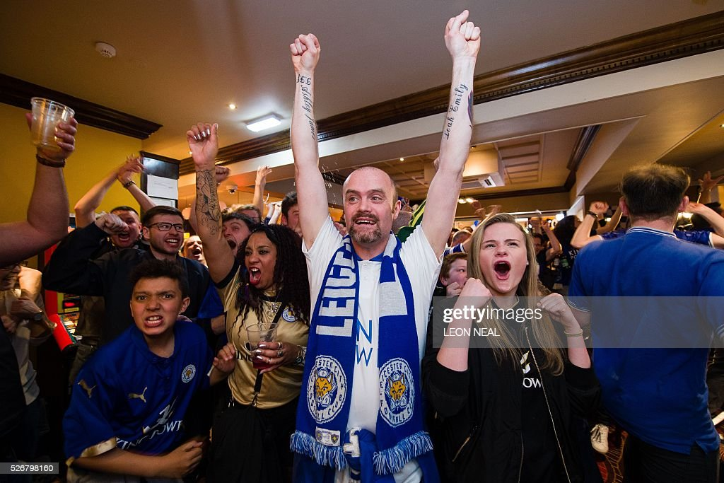 Leicester fans react after Leicester City score during the Premier league football match against Manchester United in Leicester on May 1, 2016. / AFP / LEON