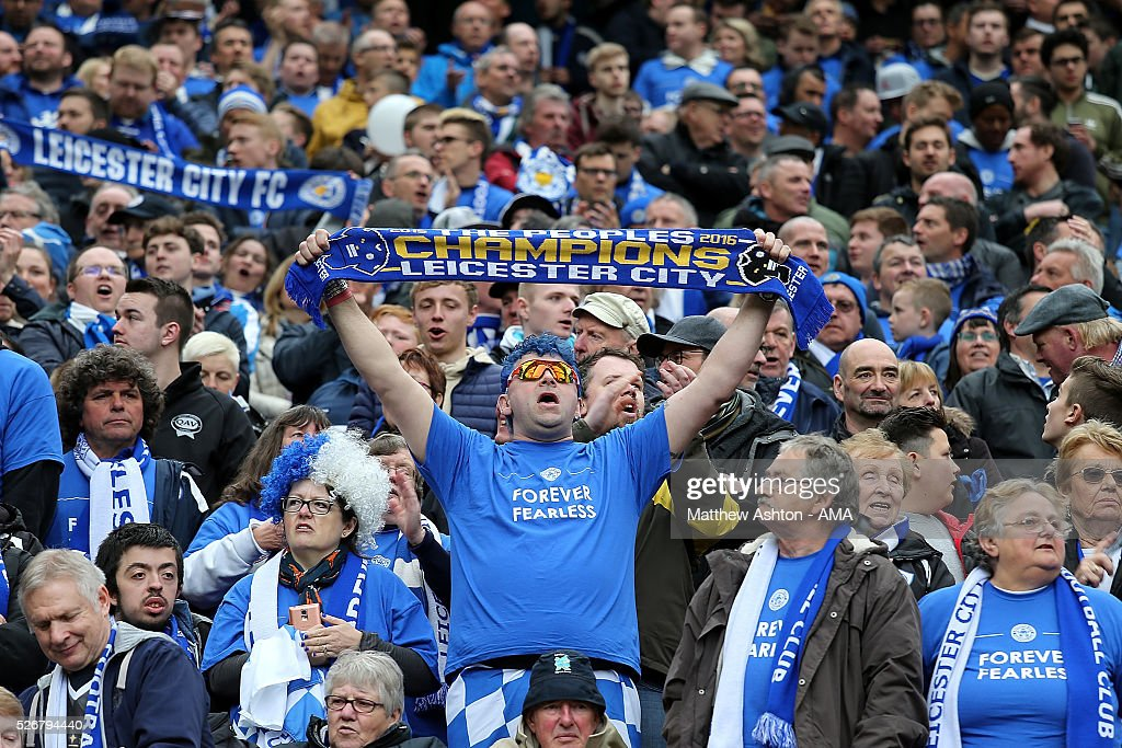 Leicester fans show their support during the Barclays Premier League match between Manchester United and Leicester City at Old Trafford on May 1, 2016 in Manchester, United Kingdom.