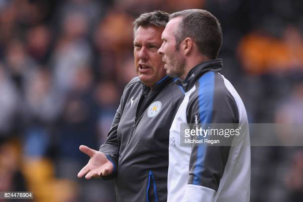 Leicester manager Craig Shakespeare speaks to assistant manager Michael Appleton during the preseason friendly match between Wolverhampton Wanderers...