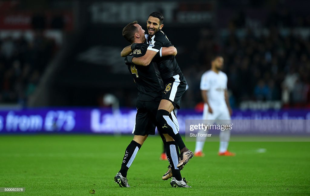 Leicester player Riyad Mahrez celebrates after scoring the first goal with Danny Drinkwater (l) during the Barclays Premier League match between Swansea City and Leicester City at Liberty Stadium on December 5, 2015 in Swansea, Wales.