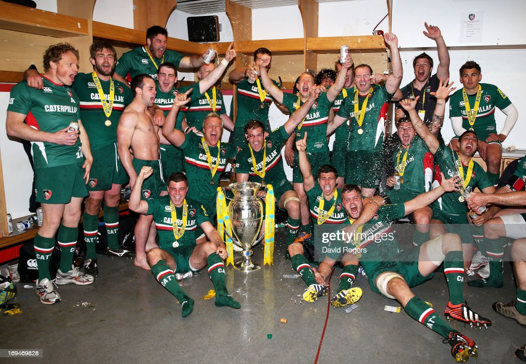 Leicester players celebrate with the trophy following their team's 37-17 victory during the Aviva Premiership Final between Leicester Tigers and Northampton Saints at Twickenham Stadium on May 25, 2013 in London, England.