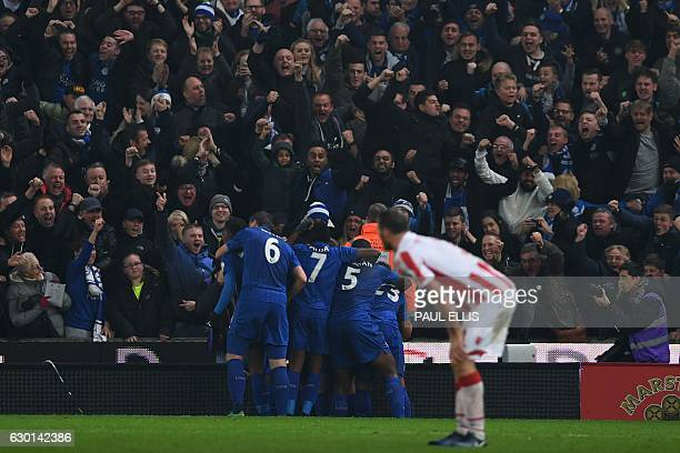 Leicester players mob Leicester City's Ghanaian midfielder Daniel Amartey after he scored his team's second goal during the English Premier League...